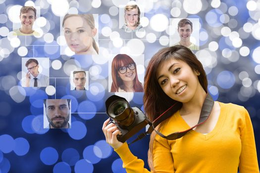 Young woman holding a camera in front of organization chart