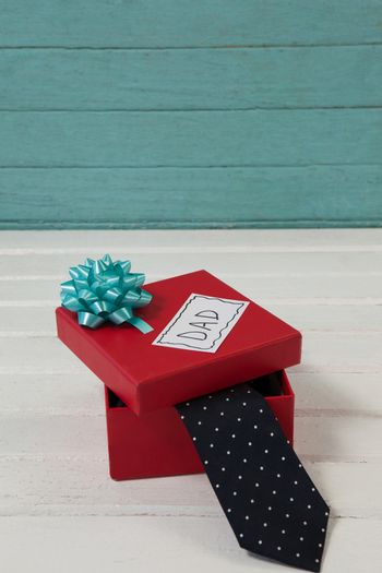 Necktie in gift box with dad text on table