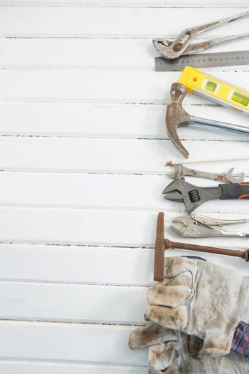 Hand tools arranged on white wooden table