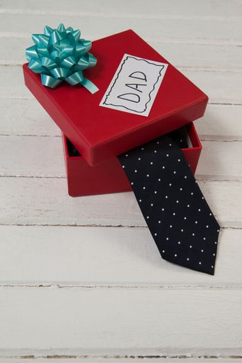 Necktie gift box with dad text on table