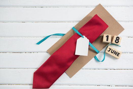 Overhead view of necktie with calendar date