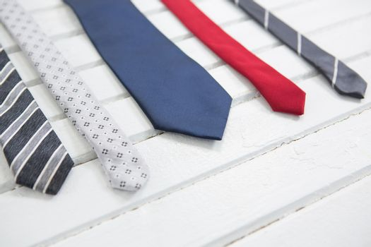 Multi colored necktie on wooden table