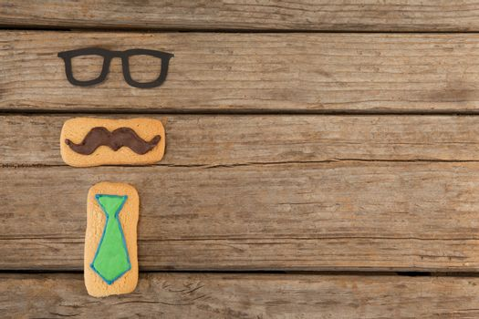 Cookies with mustache and necktie shape decorataion on table