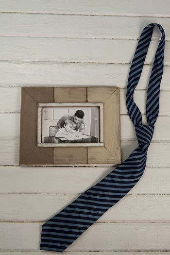Necktie by photograph on table