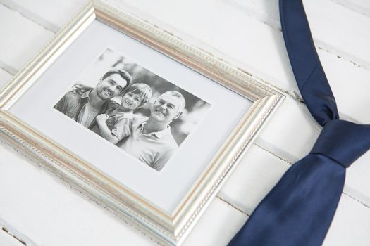 High angle view of photo frame with necktie