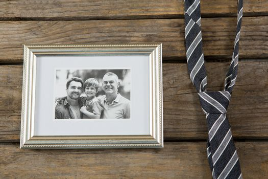 Close up of photo frame with necktie