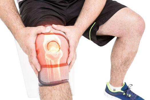 Mid section of man holding sore knee