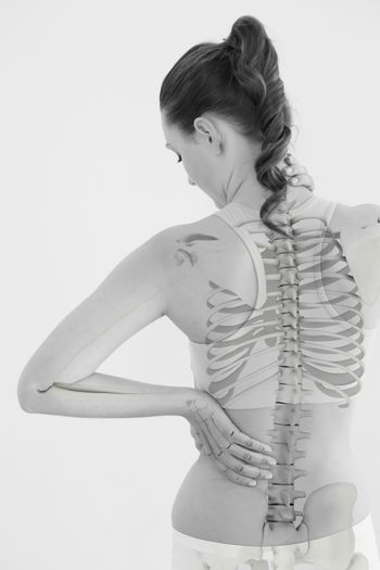 Rear view of woman suffering from muscle pain