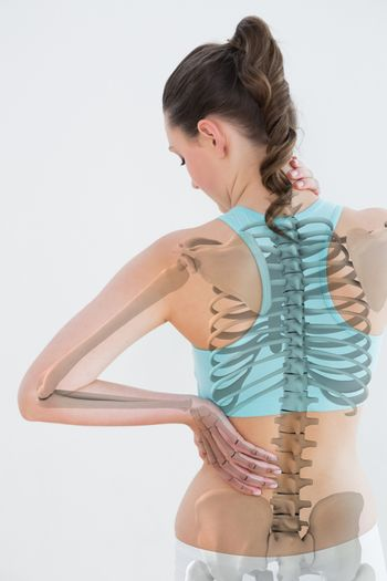 Rear view of female suffering from muscle pain