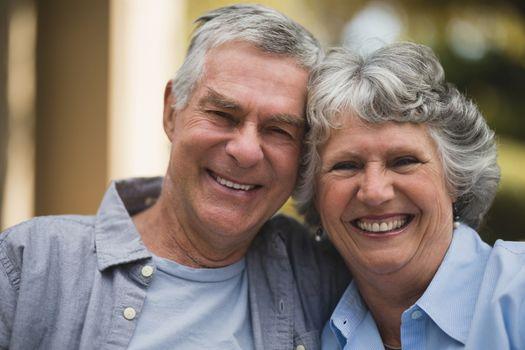 Portrait of senior couple in yard