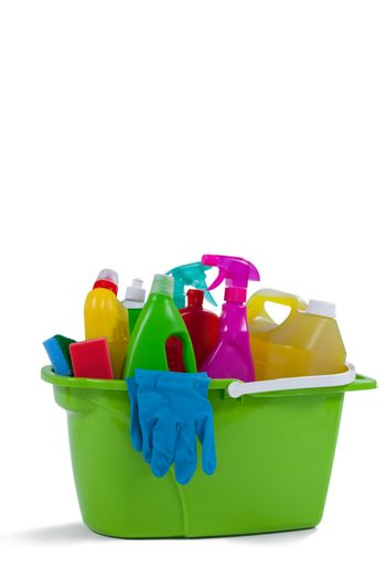 Various household cleaning supplies in a bucket