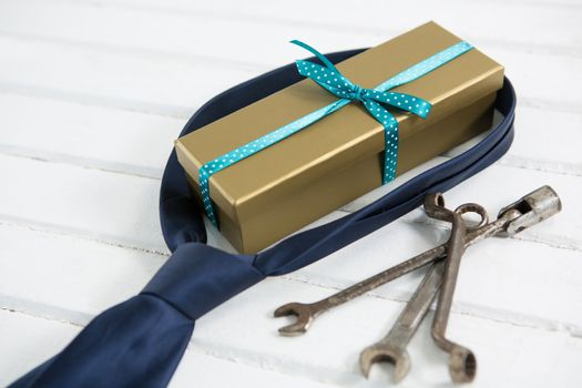 Close up of gift box with necktie and hand tools