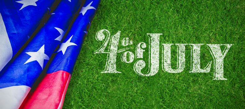 Happy 4th of july text on white background against closed up view of grass