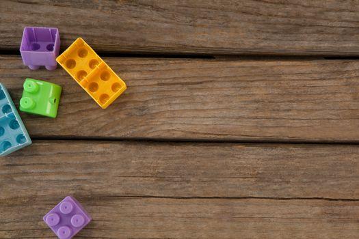 Blocks on wooden plank