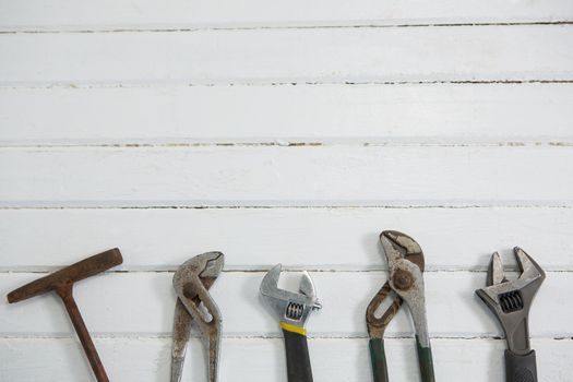 Overhead view of hand tools on white table