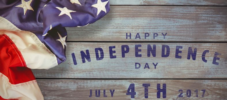 Happy 4th of july text on white background against wood