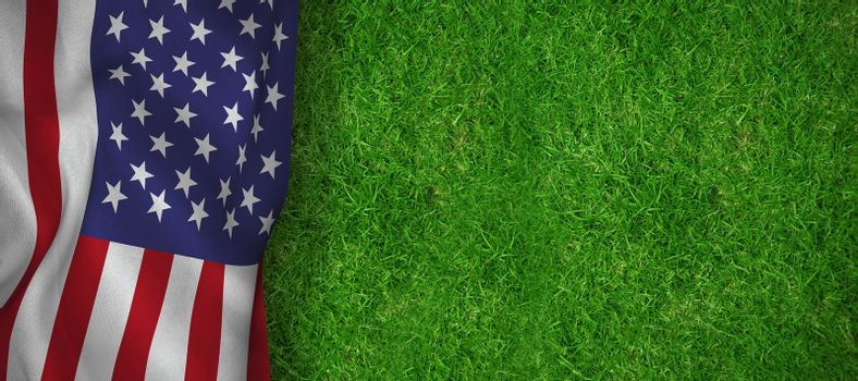 American flag against closed up view of grass