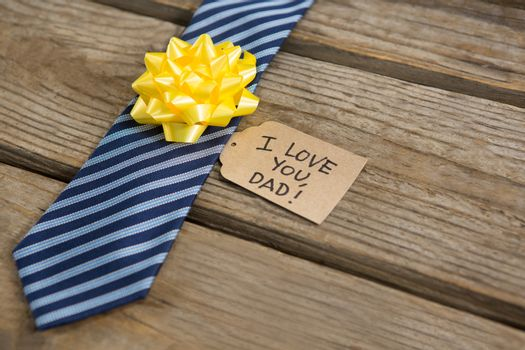 High angle view of necktie with greetings on table