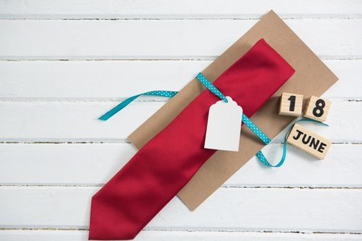 Overhead view of necktie gift by calender on table