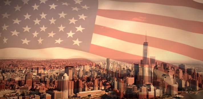 American flag against one world trade center in city by river against sky