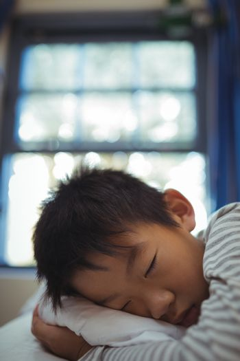 Boy sleeping on the bed in bed room