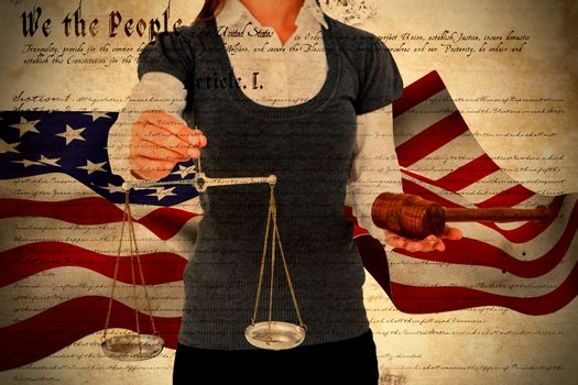 Composite image of woman holding a gavel and scales of justice