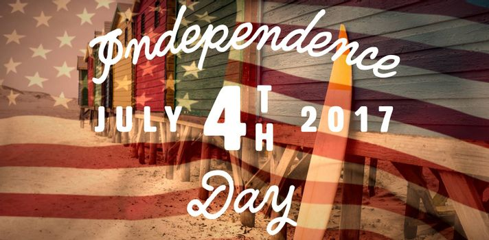 Digitally generated image of happy 4th of july message against wooden surfboard leaning on blue hut