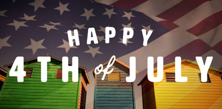 Digitally generated image of happy 4th of july text against low angle view of multi colored houses against sky