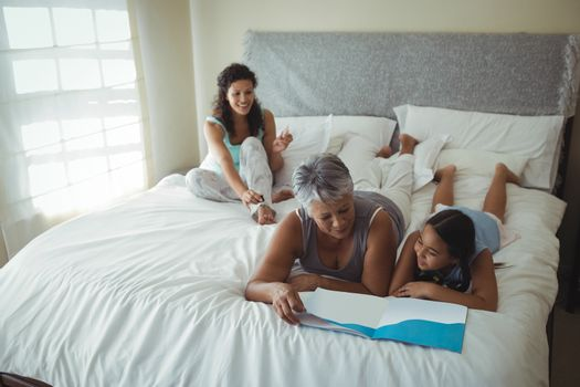 Happy family relaxing on bed in bed room