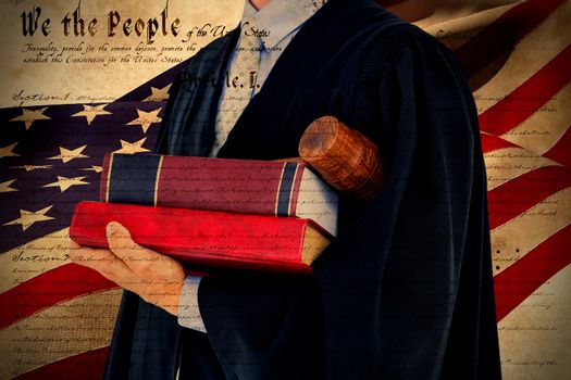 Composite image of lawyer holding scales of justice
