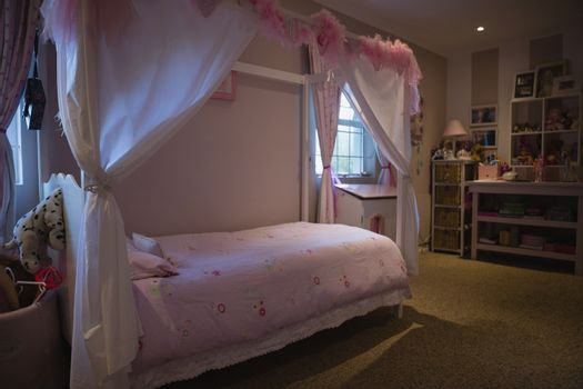 Neat bed in bedroom