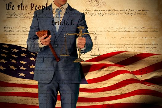 Composite image of businessman holding scales of justice