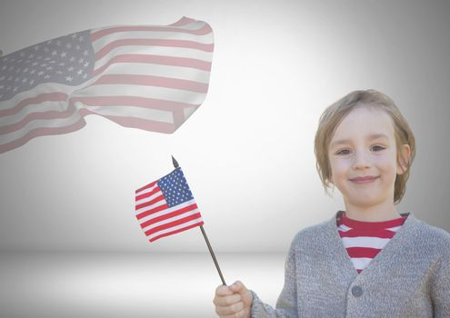 Child holding american flag in front of an other american flag