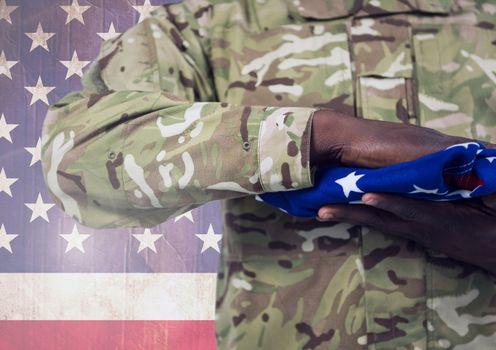 Military holding american flag against american flag
