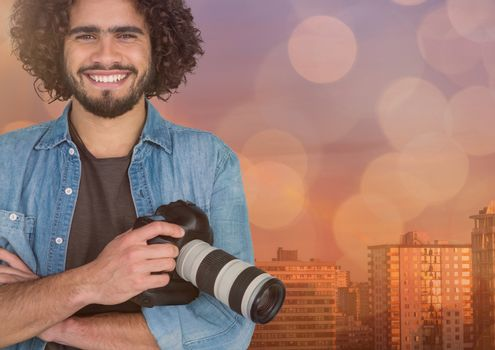happy young photographer hands folded and camera on hand in front of the city. Overlap with blue and