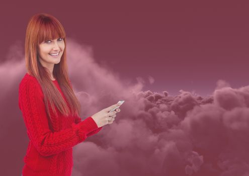 Smiling woman texting in red darkness