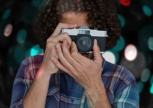 photographer taking a photo with vintage camera. Blue and red bokeh background and overlap