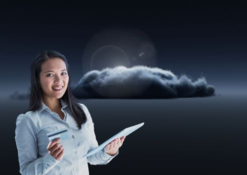 Smiling woman texting in darkness with dark clouds in background