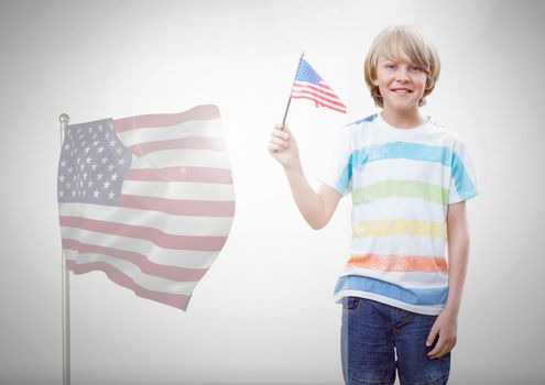 Child holding american flag in front of white background and american flag