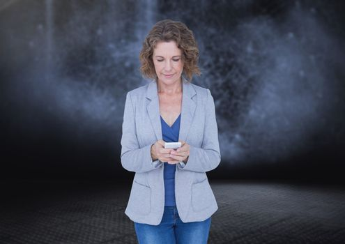 Woman texting in darkness