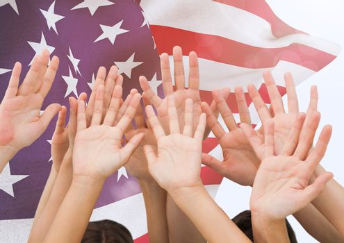 Hands up with fluttering american flag in background