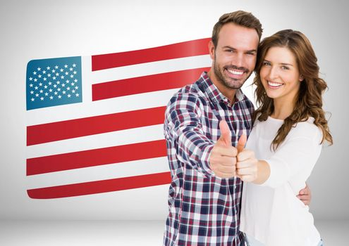 Couple thumbs up on american flag background