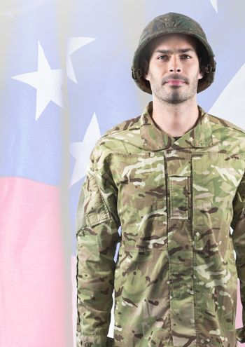 Soldier standing on american flag background