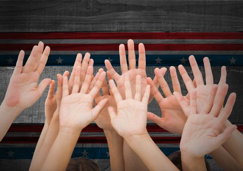 Hands up against american flag in background