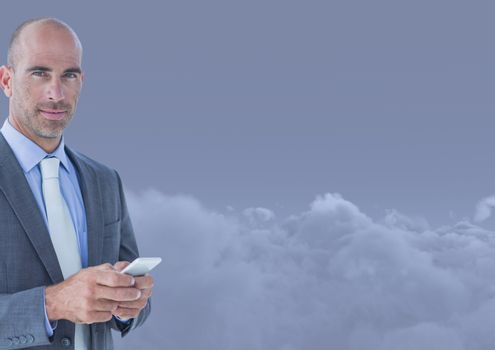 Man Texting in clouds