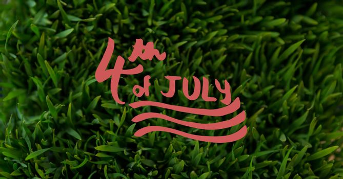 Red fourth of July graphic against grass