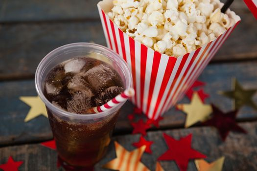 Close-up of popcorn and cold drink with 4th july theme