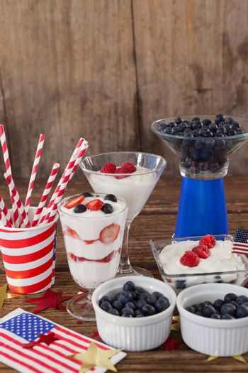 Fruits and ice cream with 4th july theme arranged on table