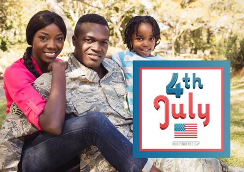 Digital composite of Smiling family siting on the grass for the 4th of july