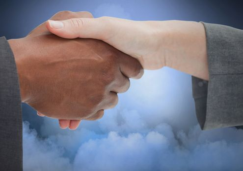 Handshake with cloudy background